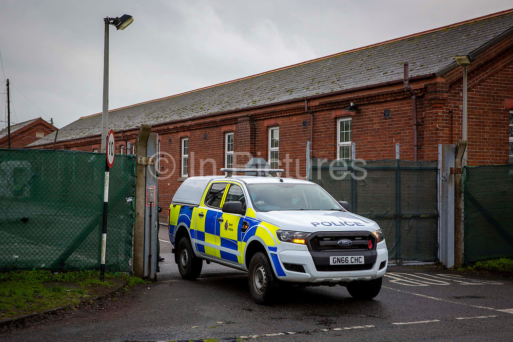 A Police vehicle leaving Napier Barracks after intelligence was received that there could be a protest outside the barracks with banners and signs got out to demonstrate about the poor conditions they are subjected to inside the holding centre on the 12th of January 2021, Folkestone United Kingdom. Police spent all day outside the holding centre in Folkestone where over 400 asylum seekers are being kept at Napier Barracks in unsuitable, cold accommodation, they are experiencing mental health issues as well as being vulnerable to health conditions including COVID-19.