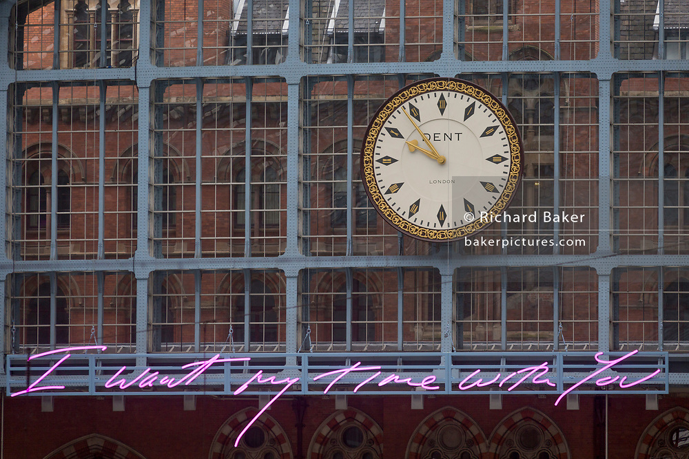 """The new artwork entitled 'I Want My Time With You' by British (Britpop) artist Tracy Emin hangs over the main concourse at St. Pancras Station, on 10th April 2018, in London, England. In the sixth year of the Terrace Wires Commission - and in celebration of the 150th anniversary of St Pancras International and the 250th anniversary of the Royal Academy of Arts, at one of London's mainline station, the London hub for Eurostar - the 20 metre-long greeting to commuters reads 'I Want My Time With You' and Emin thinks that arriving by train and being met by a lover as they put their arms around them, is very romantic."""" The Brexit-opposing artist also said she wanted to make """"a statement that reaches out to everybody from Europe arriving in to London""""."""