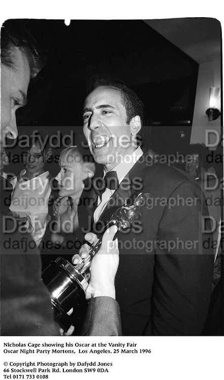 Nicholas Cage with his Oscar at the Vanity Fair Oscar Night Party Mortons,  Los Angeles. 25 March 1996<br /> <br /> © Copyright Photograph by Dafydd Jones<br /> 66 Stockwell Park Rd. London SW9 0DA<br /> Tel 0171 733 0108