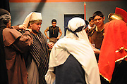 Actors at St. Jerome Catholic Parish in Chicago's Rogers Park neighborhood prepare to reenact a Via Crucis, portraying the biblical account of Jesus Christ being condemned to death, followed by his crucifixion and entombment.