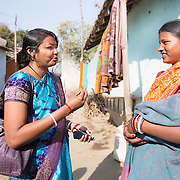 CAPTION: Community COPE members come to ask a householder about what her expectations of the health system are and what she feels ought to be done to get more people into the Government-run Community Health Centre (CHC). She says she's happy with what she's been accessing, but reveals a lack of awareness of what she is actually entitled to. Shyam Bahadur Sonar is therefore suggesting that she should discuss her needs with knowledgeable community members. LOCATION: Pawra (village), Ghatshila (block), Purbi Singhbhum (district), Jharkhand (state), India. INDIVIDUAL(S) PHOTOGRAPHED: Vandana Maitry (left) and Rupa Namata (right).