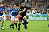 Jerome Kaino of New Zealand running with the ball while Tjiuee Uanivi of Namibia attempts to tackle him. Rugby World Cup 2015 pool C match, New Zealand v Namibia at Olympic Stadium in London on Thursday 24th September 2015.<br /> pic by John Patrick Fletcher, Andrew Orchard sports photography.