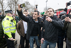 "© Licensed to London News Pictures. 11/03/2018. London, UK. Supporters of the Football Lads Alliance join alt right protesters and shout at antifascists . Alt right group Generation Identity and other far-right groups hold a demonstration at Speakers' Corner in Hyde Park , opposed by antifascists . Generation Identity supporters Martin Sellner and Brittany Pettibone were due to speak at the demo but were arrested and detained by police when they arrived in the UK , also forcing them to cancel an appearance at a UKIP "" Young Independence "" youth event , which in turn was reportedly cancelled amid security concerns . Photo credit: Joel Goodman/LNP"