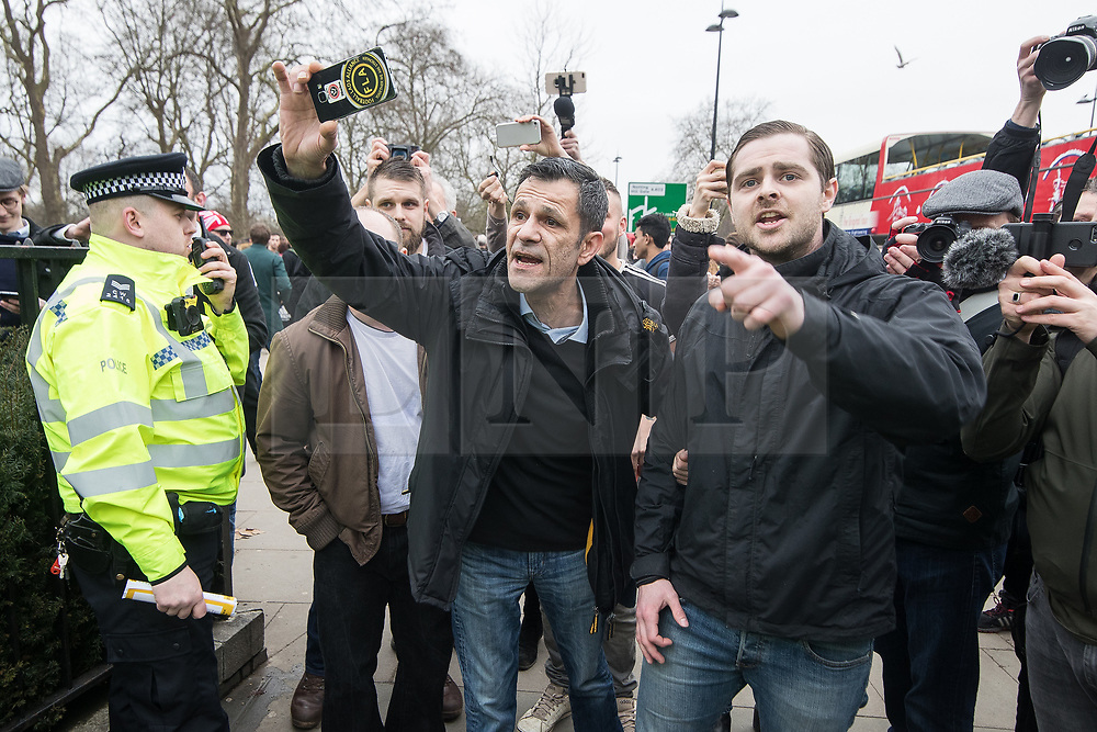 """© Licensed to London News Pictures. 11/03/2018. London, UK. Supporters of the Football Lads Alliance join alt right protesters and shout at antifascists . Alt right group Generation Identity and other far-right groups hold a demonstration at Speakers' Corner in Hyde Park , opposed by antifascists . Generation Identity supporters Martin Sellner and Brittany Pettibone were due to speak at the demo but were arrested and detained by police when they arrived in the UK , also forcing them to cancel an appearance at a UKIP """" Young Independence """" youth event , which in turn was reportedly cancelled amid security concerns . Photo credit: Joel Goodman/LNP"""