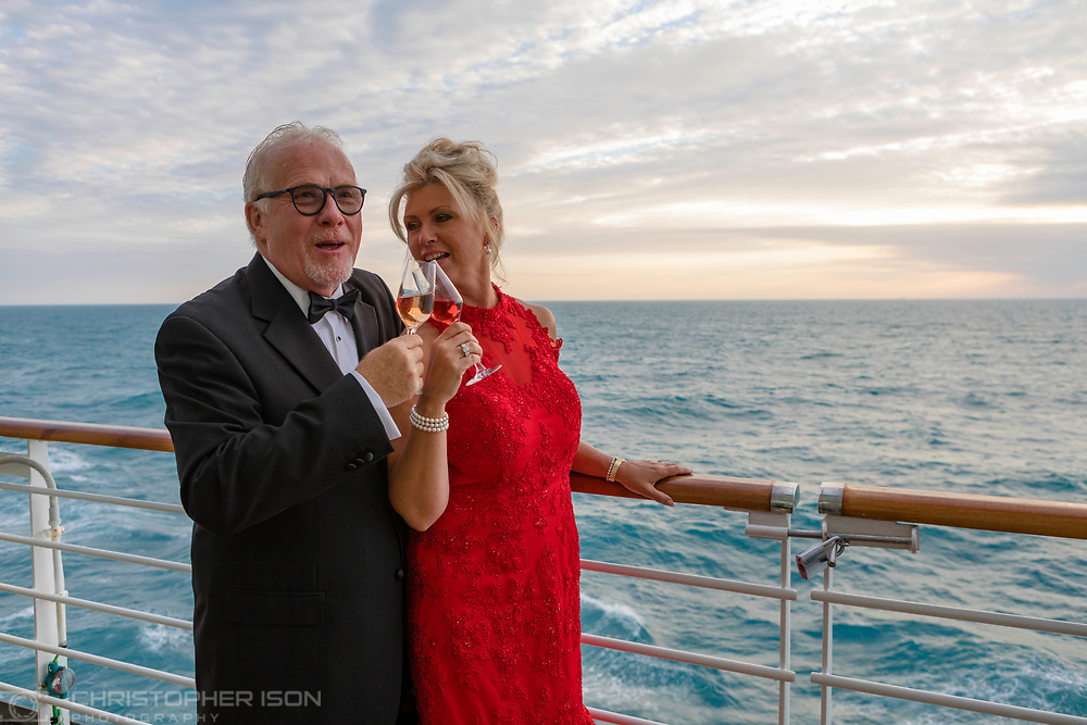 A couple enjoy the late sunset on board P&O Cruises' flagship, Britannia while cruising in Norway.<br /> Picture date: Monday June 18, 2018.<br /> Photograph by Christopher Ison ©<br /> 07544044177<br /> chris@christopherison.com<br /> www.christopherison.com
