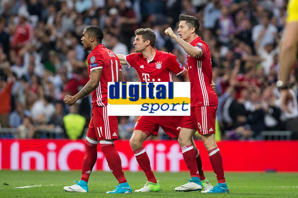 Douglas Costa, Thomas Muller and Robert Lewandowski of FC Bayern Munchen  celebrates after scoring a goal during the match of Champions League between Real Madrid and FC Bayern Munchen at Santiago Bernabeu Stadium  in Madrid, Spain. April 18, 2017. (ALTERPHOTOS)
