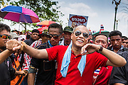 06 APRIL 2014 - BANGKOK, THAILAND: NATTAWUT SAIKUA, a Red Shirt core leader, walks through the crowd at a Red Shirt rally in a Bangkok suburb Sunday. Red Shirts and supporters of the government of Yingluck Shinawatra, the Prime Minister of Thailand, gathered in a suburb of Bangkok this weekend to show support for the government. The Thai government is dealing with ongoing protests led by anti-government activists. Legal challenges filed by critics of the government could bring the government down as soon as the end of April. The Red Shirt rally this weekend was to show support for the government, which public opinion polls show still has the support of most of the electorate.   PHOTO BY JACK KURTZ