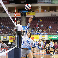 Laguna's Riley Antonio (10) with the hit in their match against Santa Fe Indian Thursday morning at the Santa Ana Star Center in the NMAA Class 3A State Volleyball tournament in Rio Rancho.