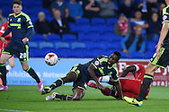 Kenneth Omeruo of Middlesbrough © slides in to deny Kenwyne Jones of Cardiff citySkybet football league championship match, Cardiff city v Middlesbrough at the Cardiff city stadium in Cardiff, South Wales on Tuesday 16th Sept 2014<br /> pic by Andrew Orchard, Andrew Orchard sports photography.