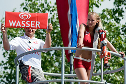 """Eskimo girl and fireman with sign """"Wasser"""" at A1 Beach Volleyball Grand Slam tournament of Swatch FIVB World Tour 2010, final, on July 31, 2010 in Klagenfurt, Austria. (Photo by Matic Klansek Velej / Sportida)"""