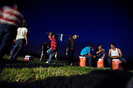 Migrant workers hang-out in the backyard of their community housing during a party celebrating a huge harvest of peaches at Titan Farms in Ridge Spring, S.C. <br /> Ridge Spring, S.C.06-17-2010. C. Aluka Berry - The State Media Company\caberry@thestate.com