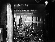 25/04/1958<br /> 04/25/1958<br /> 25 April 1958<br /> Fire at Ormond Quay, Dublin. Fireman at the scene.