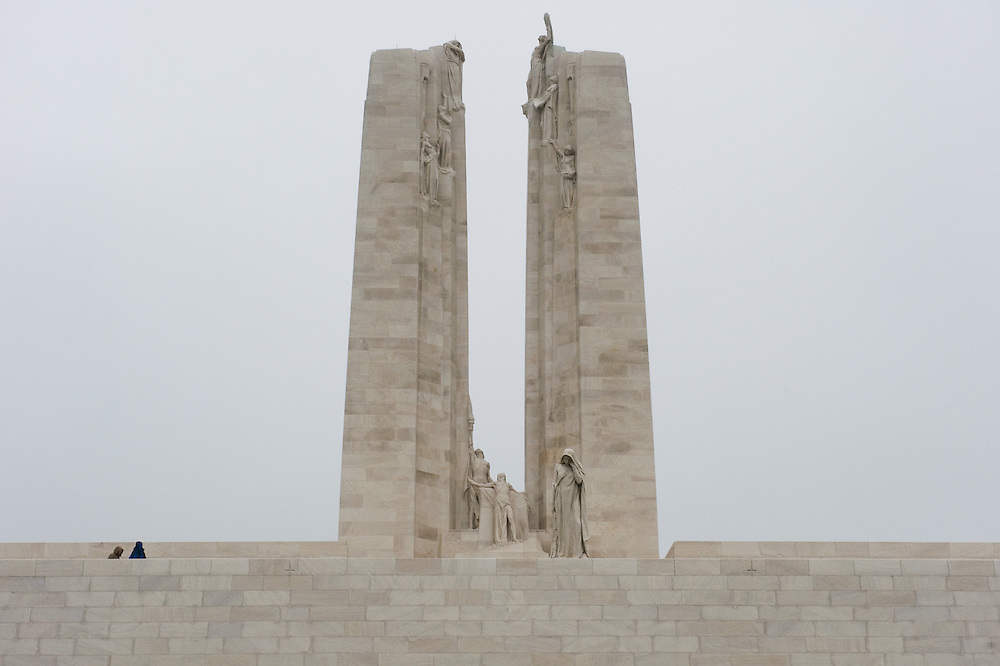 Thefront side of the Canadian National Vimy Memorial dedicated to the memory of Canadian Expeditionary Force members killed in World War one. The monument is situated at a 100 hectare preserved battlefield with wartime tunnels, trenches, craters and unexploded munitions. The memorial designed by Walter Seymour Allward opened in 1936.