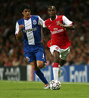 Photo: Chris Ratcliffe.<br /> Arsenal v FC Porto. UEFA Champions League, Group G. 26/09/2006.<br /> Justin Hoyte of Arsenal clashes with Lucho Gonzalez of Porto.