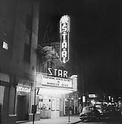 "Y-541124-2.  Night view of Star Theatre, on NW 6th between Burnside and Couch. Marquee says ""Featuring Bonita Secret in Manhaten Revue""  November 24, 1954"