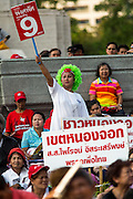 01 MARCH 2013 - BANGKOK, THAILAND: <br /> Pheu Thai supporters wait to see Pongsapat Pongchareon, the PT candidate for governor of Bangkok at the last Pheu Thai campaign rally for the Bangkok Governor's election. The election is Sunday, March 3 and no campaigning is allowed 24 hours before election day. Police General Pongsapat Pongcharoen (retired), a former deputy national police chief who also served as secretary-general of the Narcotics Control Board is the Pheu Thai Party candidate in the upcoming Bangkok governor's election. He resigned from the police force to run for Governor. Former Prime Minister Thaksin Shinawatra reportedly personally recruited Pongsapat. Most of Thailand's reputable polls have reported that Pongsapat is leading in the race and likely to defeat Sukhumbhand Paribatra, the Thai Democrats' candidate and incumbent. The loss of Bangkok would be a serious blow to the Democrats, whose national base has been the Bangkok area.    PHOTO BY JACK KURTZ