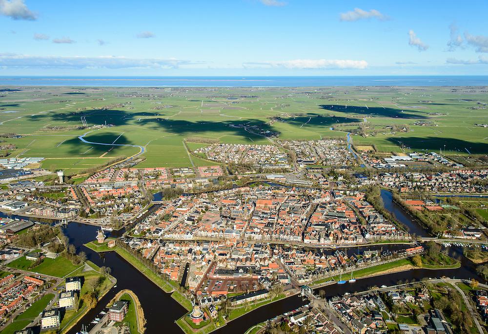 Nederland, Friesland, gemeente Dongeradeel, 28-02-2016; het landschap van de Kleistreek met Dokkum, gezien  naar de Waddenzee met Ameland aan de horizon.<br /> Dokkum, small town in the very North of Frielsland.<br />  <br /> luchtfoto (toeslag op standard tarieven);<br /> aerial photo (additional fee required);<br /> copyright foto/photo Siebe Swart