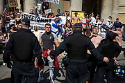 Police lines in front of Free Tommy Robinson demonstrators as they shout slogans at their opposition organised by anti-fascist groups including Stand up to Racism opposed to far right politics on 24th August 2019 in London, United Kingdom. Some 250 Stand Up To Racism and other anti-fascist groups took to the streets today in opposition to supporters of jailed 'Tommy Robinson' real name Stephen Yaxley-Lennon at Oxford Circus, who gathered outside the BBC.