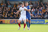 Portsmouth attacker Oliver Hawkins (9) battles for possession with AFC Wimbledon defender Rod McDonald (26) during the EFL Sky Bet League 1 match between AFC Wimbledon and Portsmouth at the Cherry Red Records Stadium, Kingston, England on 13 October 2018.