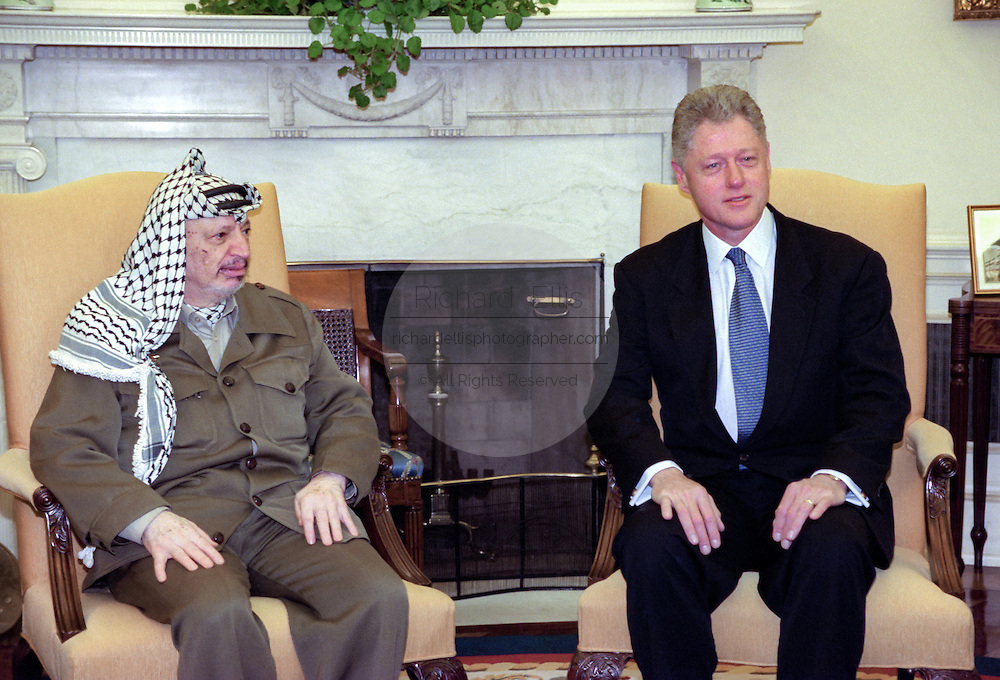 U.S President Bill Clinton welcomes Palestinian Authority President Yasser Arafat at the start of their meeting in the Oval Office of the White House November 30, 1998 in Washington, DC. Arafat is in Washington for a conference on aid to help the Palestinian's establish an independent entity.