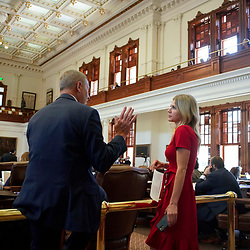 The Texas House debating SB 7 late into the night  a controversial omnibus elections bill that would make changes to the way Texas elections are held.  State Rep. Lacey Hull, R-Houston, talking with a colleague during the debate.