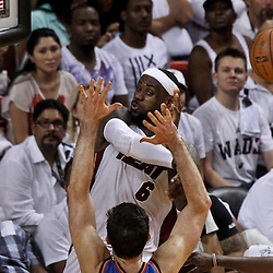 Jun 21, 2012; Miami, FL, USA; Miami Heat small forward LeBron James (6) passes as Oklahoma City Thunder power forward Nick Collison (4) defends during the fourth quarter of the 2012 NBA Finals at the American Airlines Arena. Miami won 121-106. Mandatory Credit: Derick E. Hingle-US PRESSWIRE