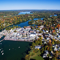 Aerial of Damariscotta, Maine Pumpkinfest weeklong festival of pumpkins! Road pictured is U.S. Highway 1 which runs through the center of the twin villages, Newcastle and Damariscotta, Maine.  Parade through town is one of the largest in the area.