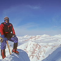 Gordon Wiltsie stands atop a sub summit of Mount Vaughan while guiding Norman Vaughan up his namesake mountain in the Trans-Antarctic Mountains of Antarctica.