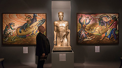 """© Licensed to London News Pictures. 29/06/2016. London, UK.  A man views """"Pelleas"""" by Eric Aumonier, a sculpture originally commissioned for the Daily Express lobby in Fleet Street in 1931, at the preview, in Chelsea, of Masterpiece London, the leading international fair for art and design from antiquity to the present day with works from 154 world-renowned exhibitors on sale.  The fair is open until 6 July.Photo credit : Stephen Chung/LNP"""
