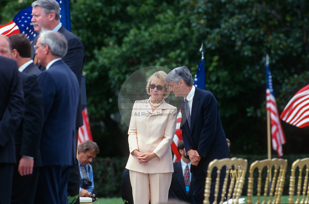 WASHINGTON, DC, USA - 1997/08/05: U.S. First Lady Hillary Clinton talks with Treasury Secretary Robert Rubin during the signing ceremony for the balanced budget bill on the South Lawn of the White House August 5, 1997 in Washington, DC.  (Photo by Richard Ellis)
