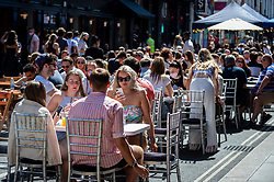 © Licensed to London News Pictures. 12/06/2021. LONDON, UK. Outdoor diners in Soho.  Scientific advisers to the UK government have called for a delay to the complete lifting of coronavirus lockdown restrictions on 21 June, possibly by four weeks, to allow scientists to assess the link between rising numbers of Covid-19 cases (mainly the newly identified Delta variant) and hospital admissions.  Photo credit: Stephen Chung/LNP
