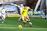Alex Mowatt of Leeds united shields the ball from Harry Bunn of Huddersfield Town. Skybet football league Championship match, Huddersfield Town v Leeds United at the John Smith's Stadium in Huddersfield, Yorks on Saturday 7th November 2015.<br /> pic by Chris Stading, Andrew Orchard sports photography.