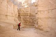 Israel, Judaean Desert, a hiker in Wadi Pratzim, The flash floods carve a deep canyon in the soft chalk sedimentary rock