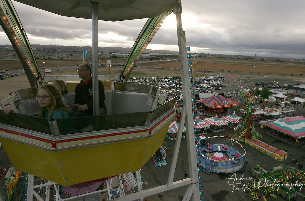 /Andrew Foulk/For The Californian/.Annah Disenhouse, 11, of Riverside,  looks over the Perris fairgrounds as she rides the Ferris wheel with her father Bruce, and her sister Abbey, 8,   at the Southern California Fair in Perris.