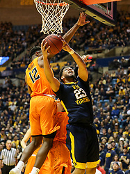 Feb 10, 2018; Morgantown, WV, USA; West Virginia Mountaineers forward Esa Ahmad (23) shoots underneath the basket during the second half against the Oklahoma State Cowboys at WVU Coliseum. Mandatory Credit: Ben Queen-USA TODAY Sports