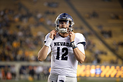 Nevada quarterback Carson Strong (12) awaits the start of play before an NCAA college football game against California, Saturday, Sept. 4, 2021, in Berkeley, Calif. (AP Photo/D. Ross Cameron)