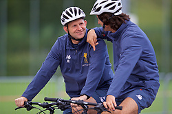 ROTTACH-EGERN, GERMANY - Friday, July 28, 2017: Liverpool's goalkeeping coach John Achterberg and assistant manager Zeljko Buvac cycle back to the team hotel after a training session at FC Rottach-Egern on day three of the preseason training camp in Germany. (Pic by David Rawcliffe/Propaganda)