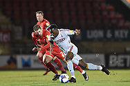 Bradford City's Austin Samuel (14) battles for possession with Leyton Orient's Sam Ling(2) during the EFL Sky Bet League 2 match between Leyton Orient and Bradford City at the Breyer Group Stadium, London, England on 24 November 2020.
