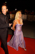 Donatella  Versace, Fashion Rocks in aid of the Princes trust, royal albert Hall, 15  october 2003.   © Copyright Photograph by Dafydd Jones 66 Stockwell Park Rd. London SW9 0DA Tel 020 7733 0108 www.dafjones.com