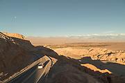 Road through Valle de la Luna on sunny day, Atacama Desert, Chile