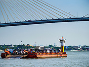 22 JANUARY 2019 - PHRA PRADAENG, SAMUT PRAKAN, THAILAND:  A motorcycle and vehicle ferry crosses the Chao Phraya River under the Bhumibol 2 Bridge in Phra Pradaeng, in the suburbs south of Bangkok. The use of vehicle ferries across the river has gone down as the government has built bridges to connect communities on both sides of the river. The Phra Pradaeng ferries are the busiest vehicle ferries in the Bangkok metropolitan area. Since the BTS Skytrain now comes close to the ferry, the number of commuters going into Bangkok that use the ferry has increased.    PHOTO BY JACK KURTZ