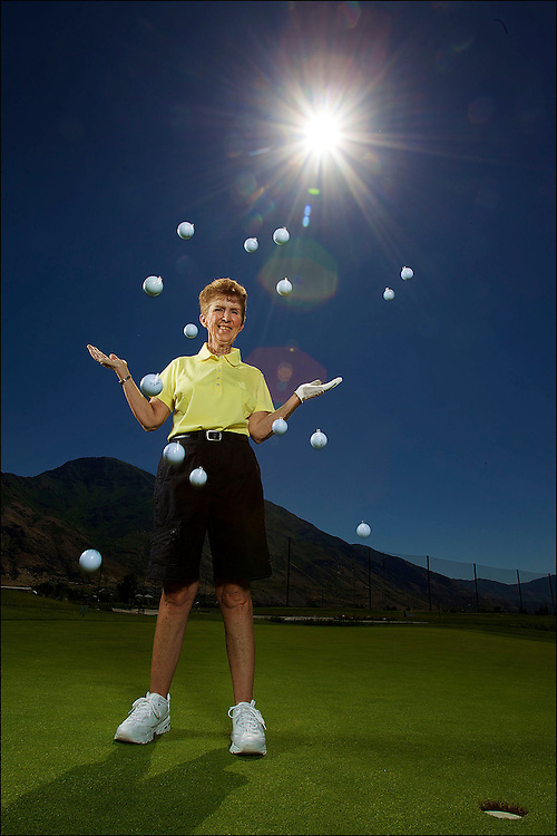 Mary Norman, one of the most dominating female golfers in Provo, just had her 15th hole in one. Here she poses for a portrait with 15 golf balls in the air at East Bay Golf Course in Provo, Utah, Saturday, July 10, 2010. (August Miller)