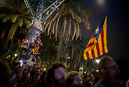 People reacting sadly after the president of Catalunia Carles Puigdemont announces that he will take time before declaring indipendency