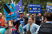 Brexit protesters and Anti Brexit protester Steve Bray dance with people from the Hare Krishna movement, whi came to College Green to spread some joy in Westminster on the day after Parliament voted to take control of Parliamentary proceedings and prior to a vote on a bill to prevent the UK leaving the EU without a deal at the end of October, on 5th September 2019 in London, England, United Kingdom. Yesterday Prime Minister Boris Johnson faced a showdown after he threatened rebel Conservative MPs who vote against him with deselection, and vowed to aim for a snap general election if MPs succeed in a bid to take control of parliamentary proceedings to allow them to discuss legislation to block a no-deal Brexit.