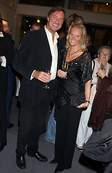 LORD BROCKETT and his fiance HARRIET WARREN at a private view of fashion designer Lindka Cierach's Couture Dresses drawn by Trudy Good held at the Belgravia Gallery, 45 Albemarle Street, London on 21st September 2005.<br />