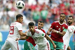 (l-r) Majid Hosseini of IR Iran, Ghanem Saiss of Morocco , Morteza Pouraliganji of IR Iran , Mehdi Benatia of Morocco