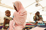 A woman holds her recovering malnourished child at a UNICEF-sponsored therapeutic feeding center at the Mongo hospital in the town of Mongo, Guera province, Chad on Tuesday October 16, 2012.