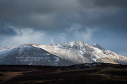 Beyond the illusory warmth of foreground moors, stood the frozen twin peaks of Arenig Fawr, briefly illuminated by moments of temperamental winter sunlight.<br />