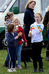 Savannah Phillips, Isla Phillips and Mia Tindall (L) enjoying ice creams during the Land Rover Novice & Intermediate Horse Trials at Gatcombe Park on March 23, 2019.
