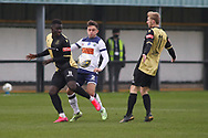 Marine forward Mo Touray (10) and Havant and Waterlooville defender Benny Read (2)  tussle for the ball during the The FA Cup match between Marine and Havant & Waterlooville FC at Marine Travel Arena, Great Crosby, United Kingdom on 29 November 2020.